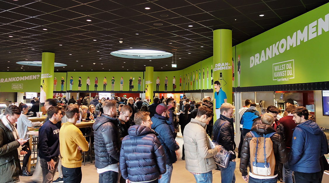 UniBranding auf der WU - next Level Studentenmarketing. Österreichs eindrucksvollstes Uni-Branding im Herzen der WU Mensa. Media in Progress ist die beste Agentur für Studentenwerbung. Buchen Sie jetzt Ihre Uni-Kampagne und gewinnen Sie die Zielgruppe Studenten als Kunden.